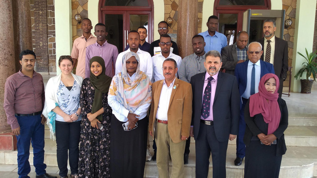 Group of Tropical Data training participants and trainers stand for a portrait together in Sudan.