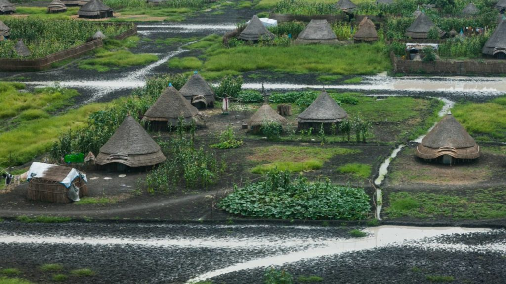Houses among the wet, lush landscape of rural Nasir County in Sout Sudan.