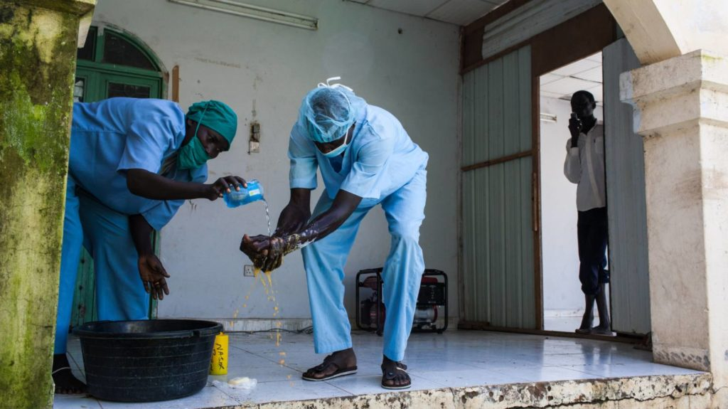 Surgeons wash their hands after performing an eye surgery in Nasir, South Sudan.