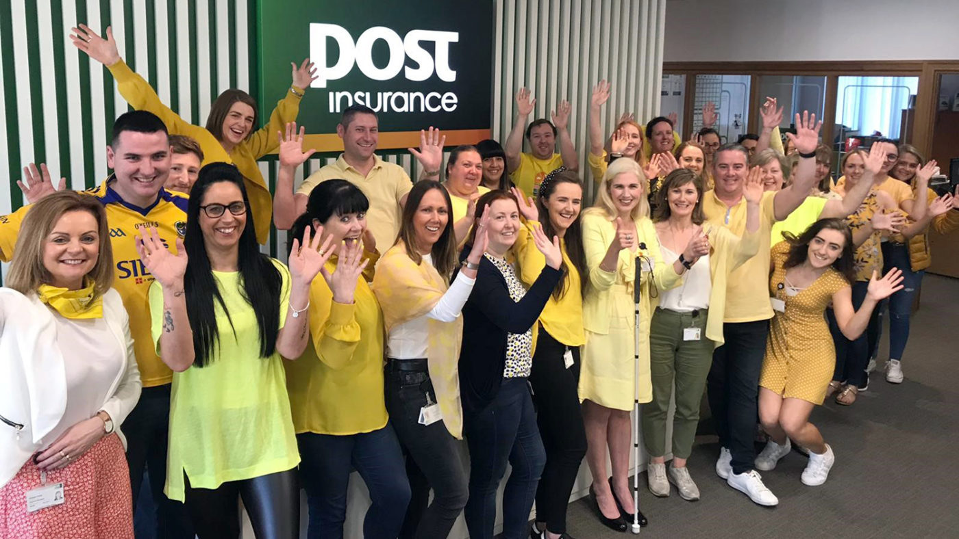 Staff from Post Insurance wearing yellow.