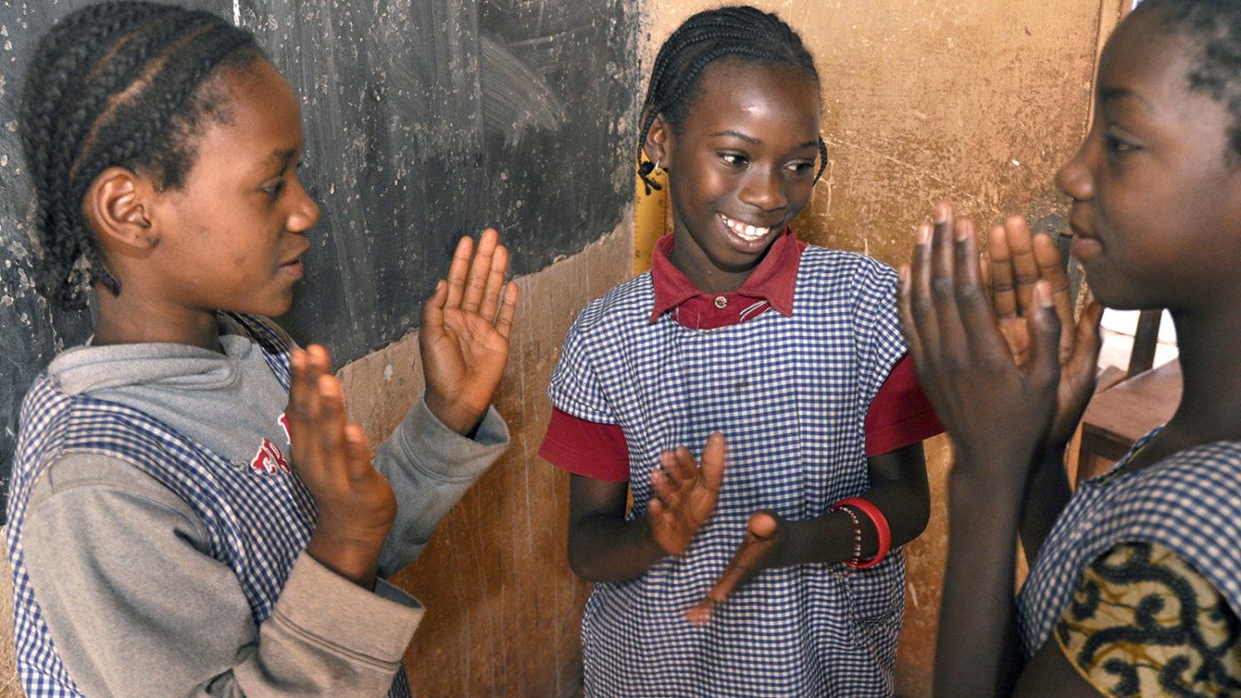 Three girls at school in Guinea.