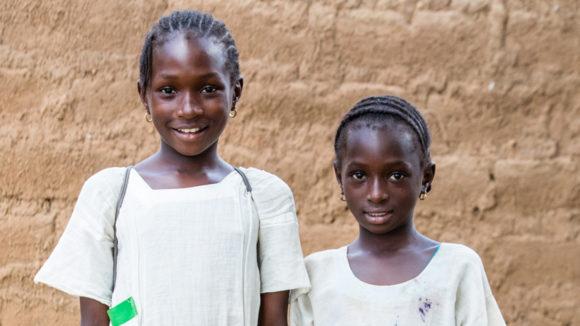 Two smiling girls.