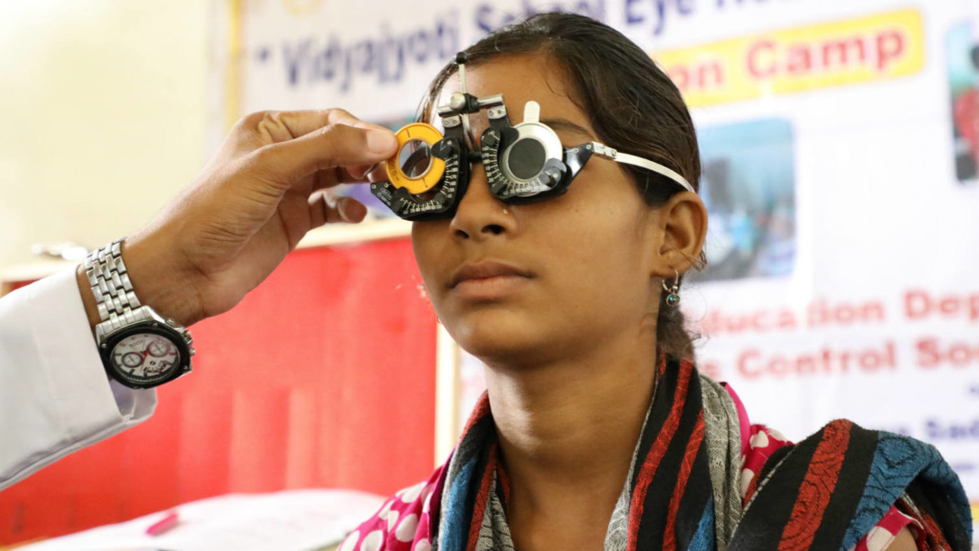 Indian girl at a school eye test