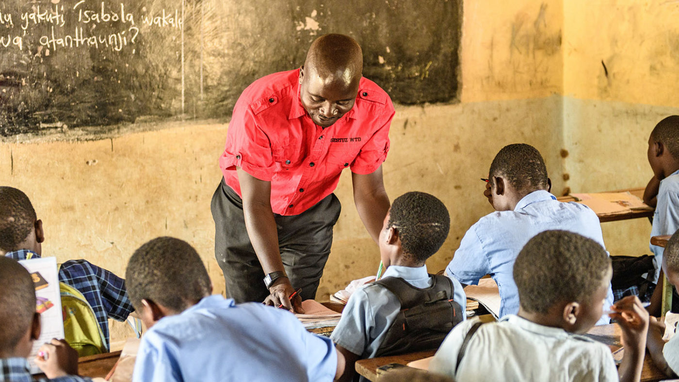 A teacher in his classroom at a school in Zambia