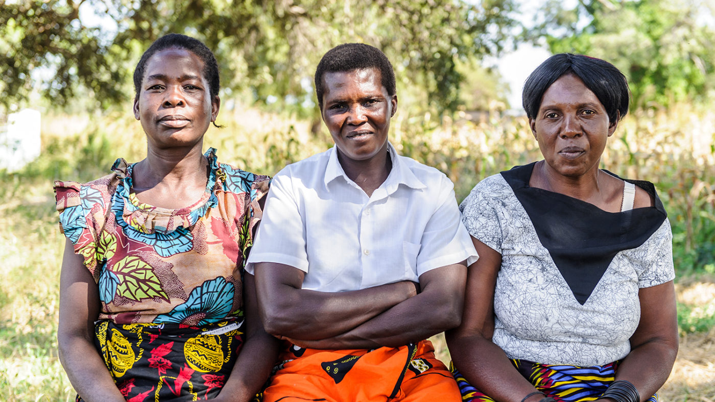 Three trachoma case finders from Zambia pose for a photo.