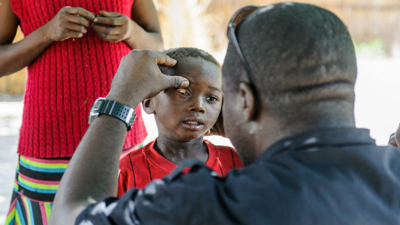 Sightsavers trachoma doctor checking eyes in remote village