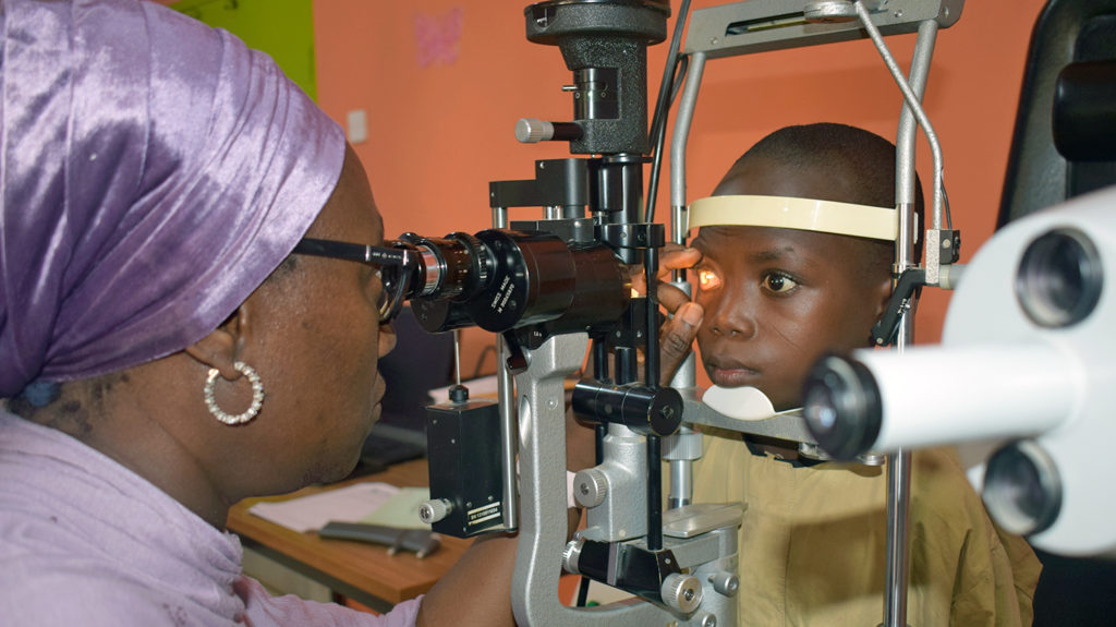 A child in Nigeria has their eyes checked for cataracts.