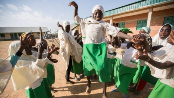 Children celebrate at school leading up to the one billionth NTD treatment.