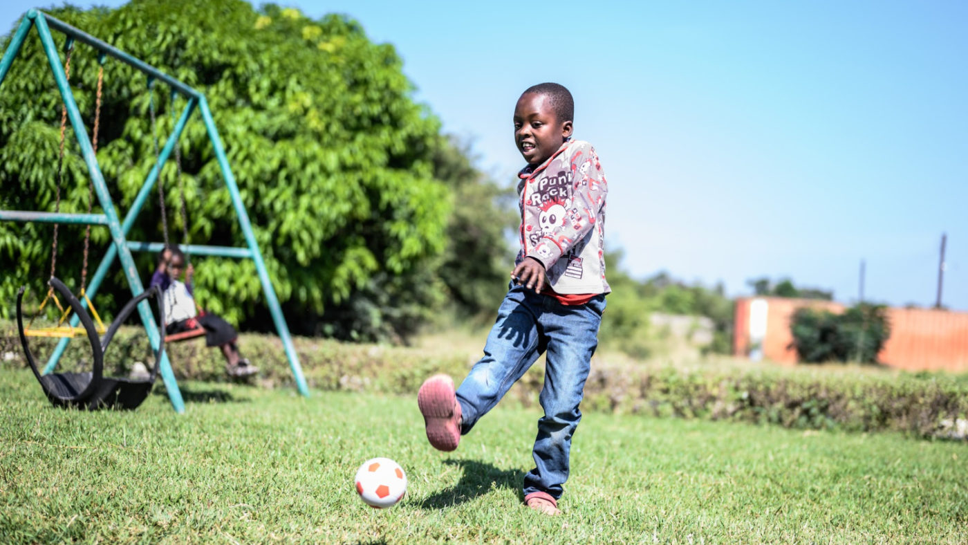 Lovemore kicks a football after his bandages have been removed