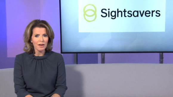 A still from Sightsavers' film with ITN, showing presenter Natasha Kaplinsky alongside the Sightsavers logo.