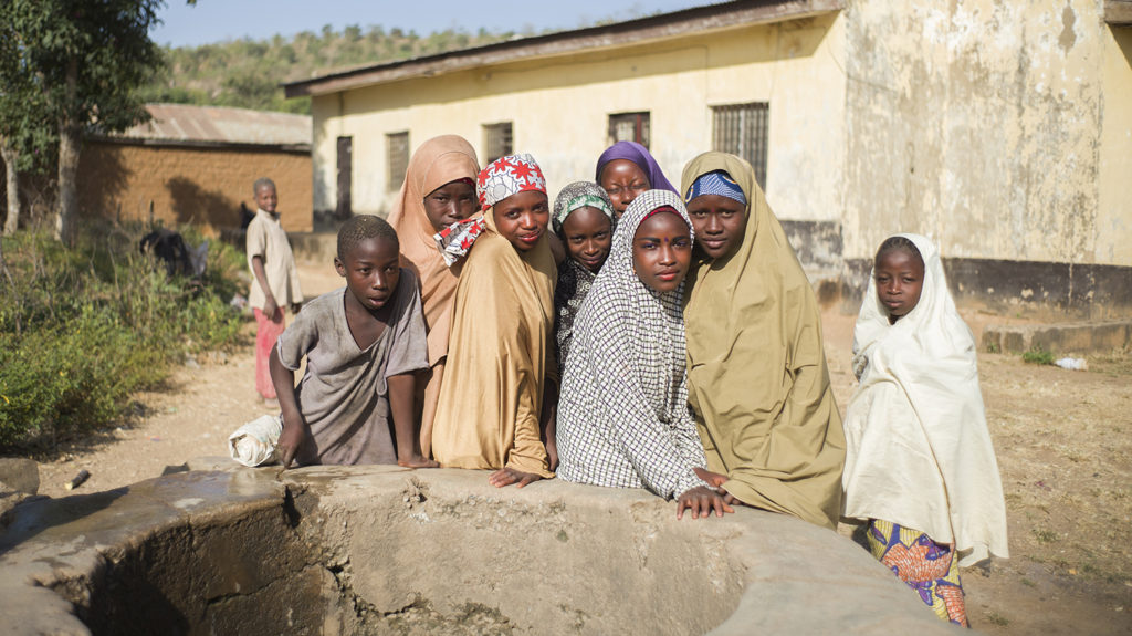 A group of children from Kaduna in Nigeria gather around the village well.