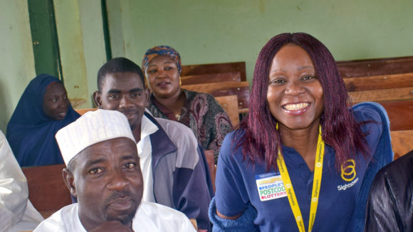 Selben smiles with a group of health staff in Nigeria.