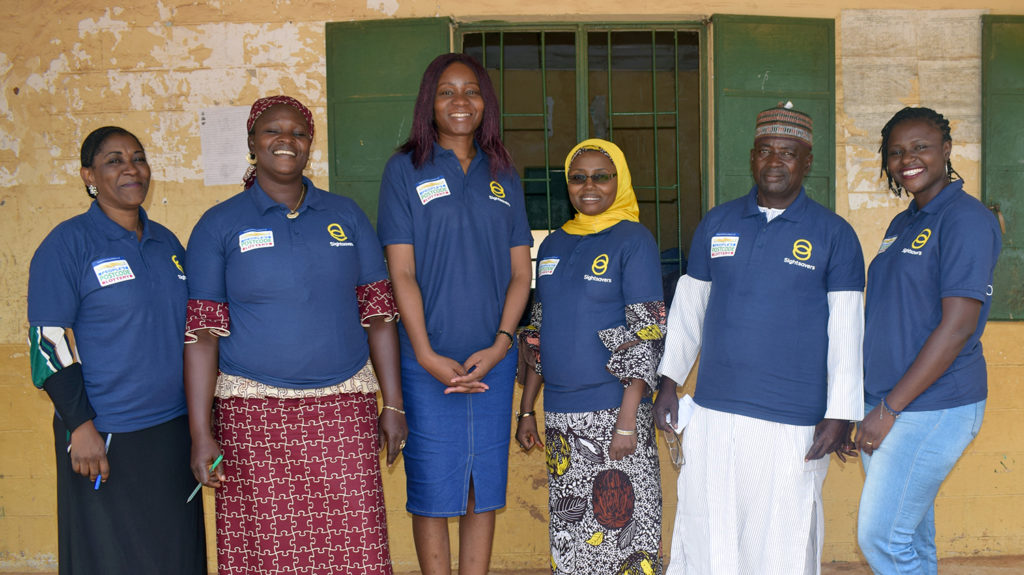 Selben smiles with a group of trainers in Kaduna, Nigeria.