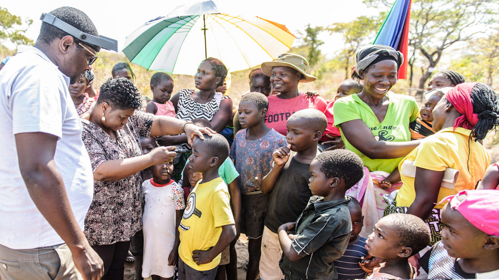 In Zimbabwe, case finders check children's eyes for signs of trachoma.