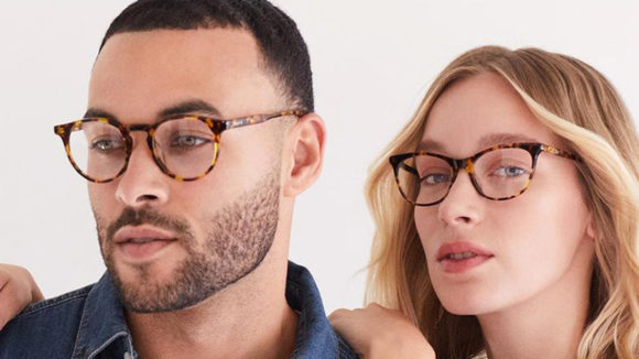 Two models wearing DIFF glasses, from the DIFF advertising campaign.