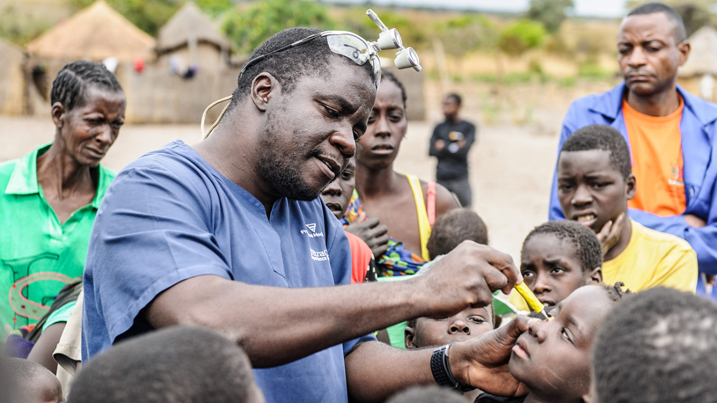 Dr Ndalela examines a child's eyes for signs of trachoma.