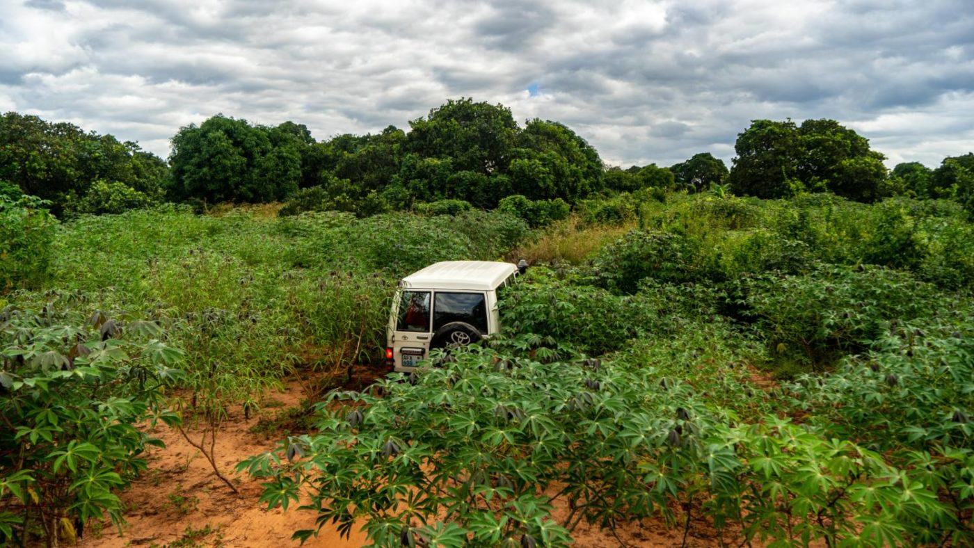 A car drives through very rough terrain to access remote villages in Nampula, Mozambique.