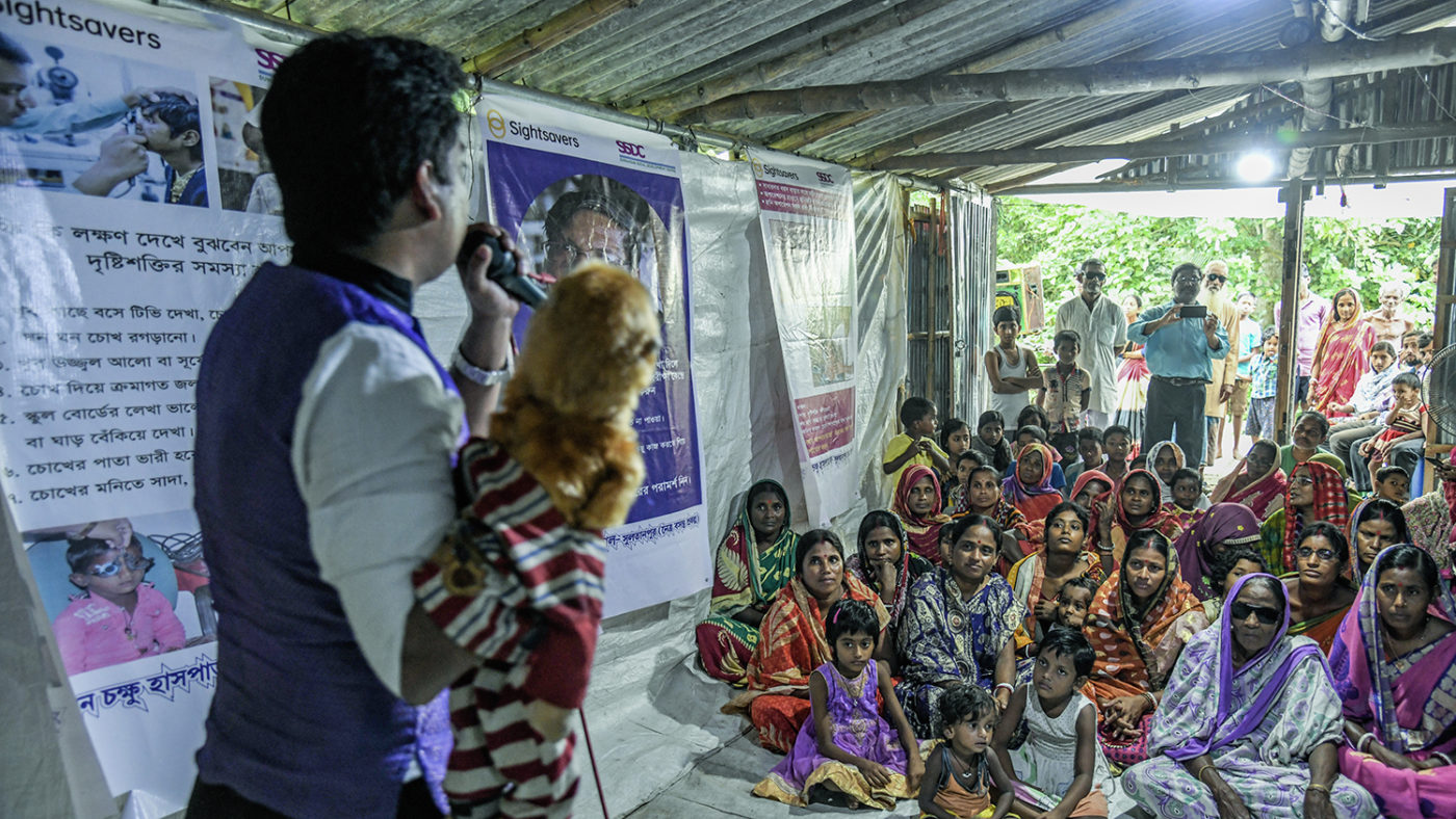 A man holds a puppet at a show in Sundarbans, India.