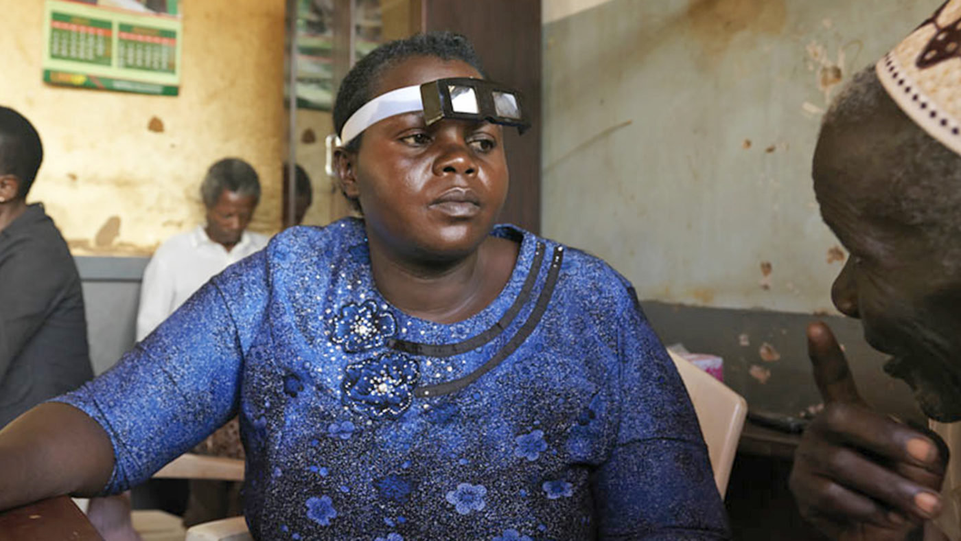 Ruth carries out an eye examination on a patient.