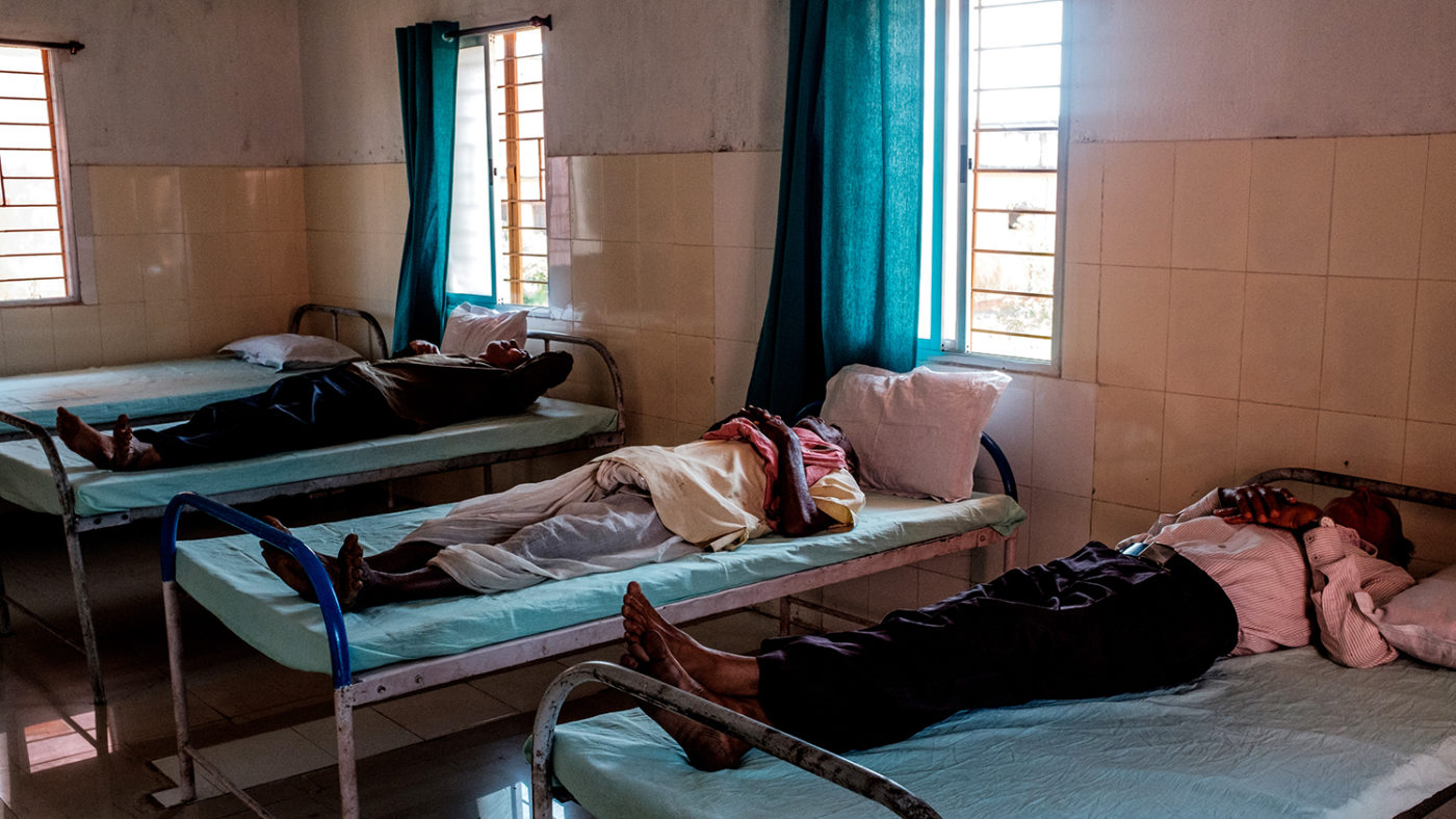 Cataract patients laying in hospital beds.
