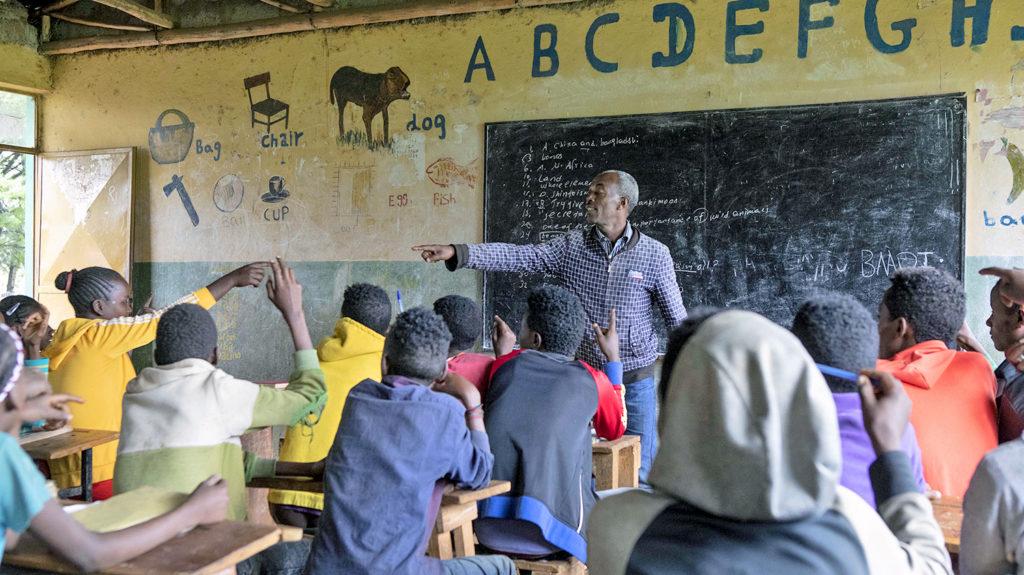 A teacher in Ethiopia teaching his class about good hygiene.