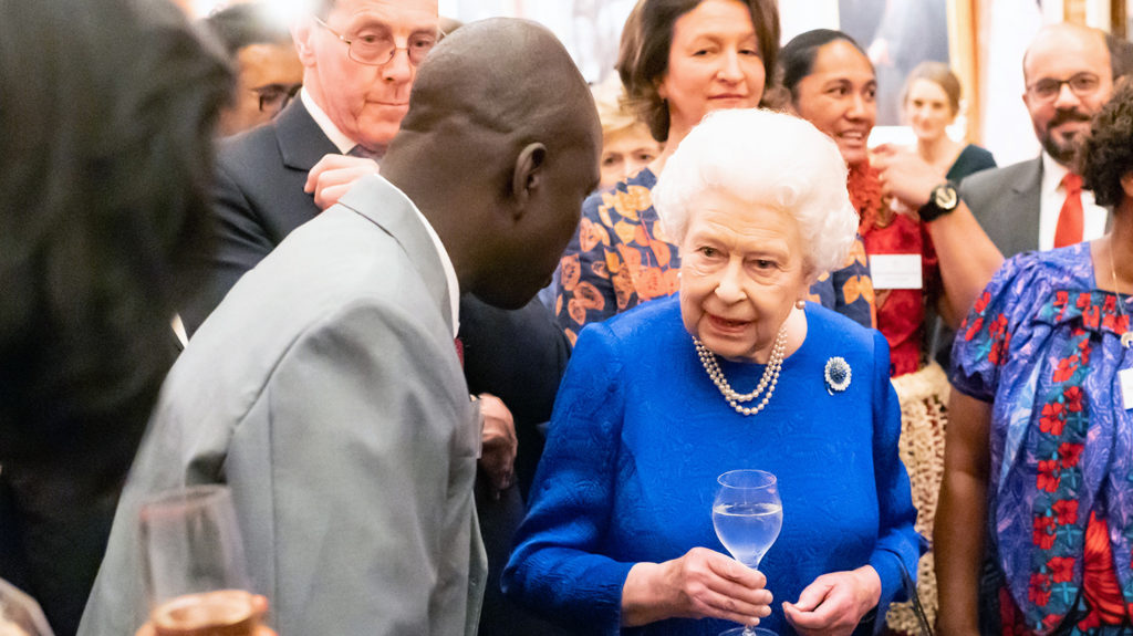 Samson Lokele talks to Queen Elizabeth at Buckingham Palace.