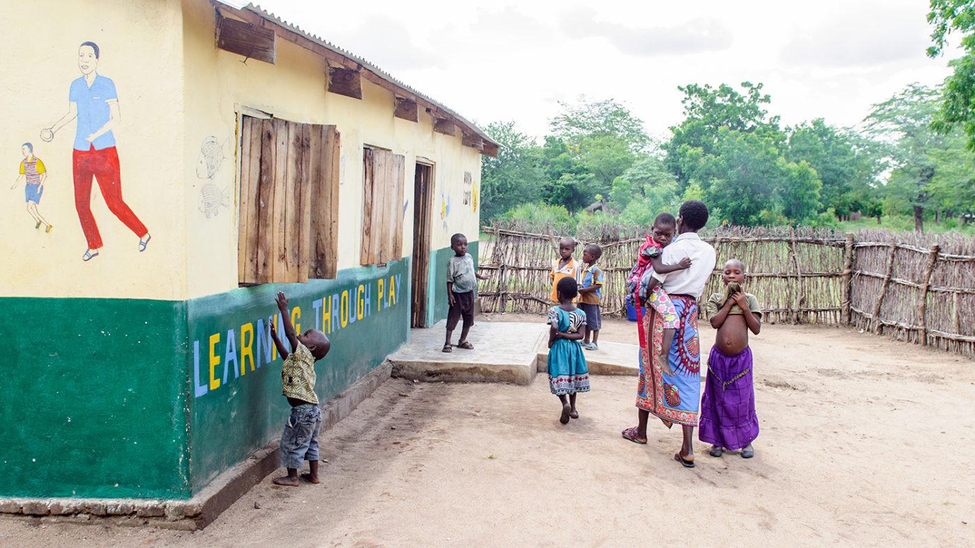 Children enter a pre-school in Malawi.