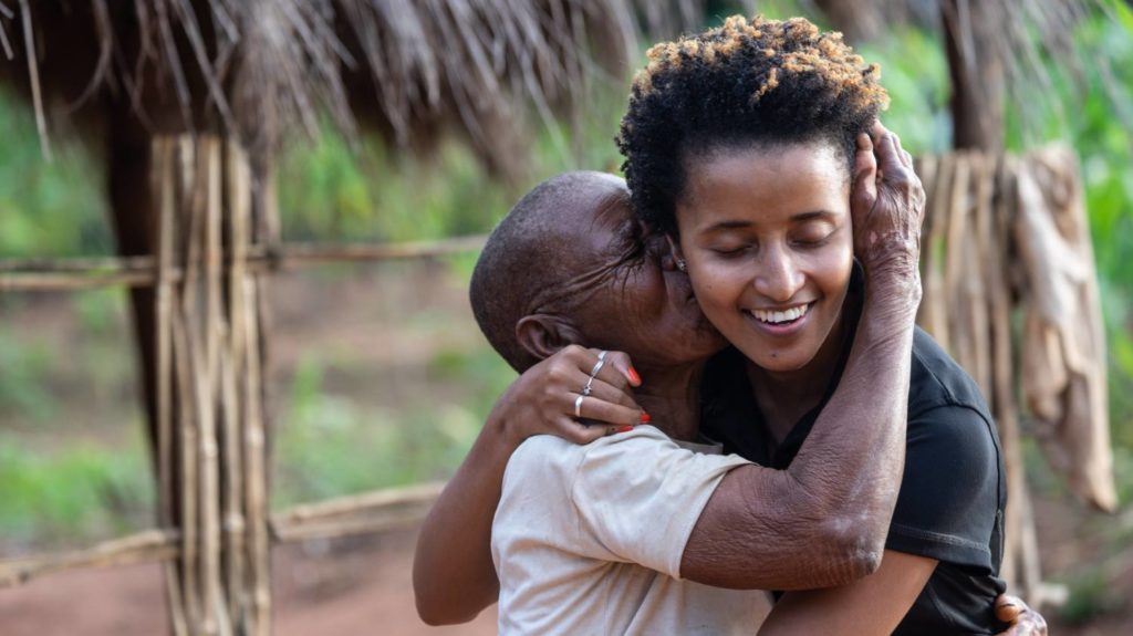 Trachoma patient Maria Fonte gives Mercia a hug after the bandages are removed from her eyes following sight-saving surgery.