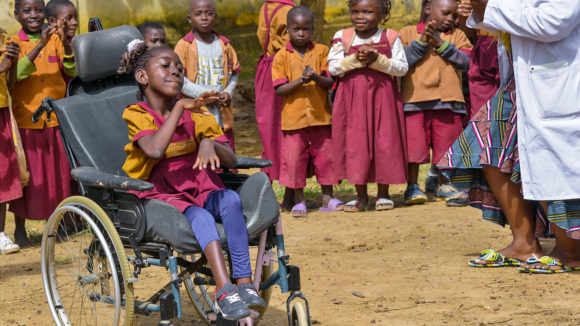 Lesline, who uses a wheelchair, with her classmates at her inclusive school in Cameroon.