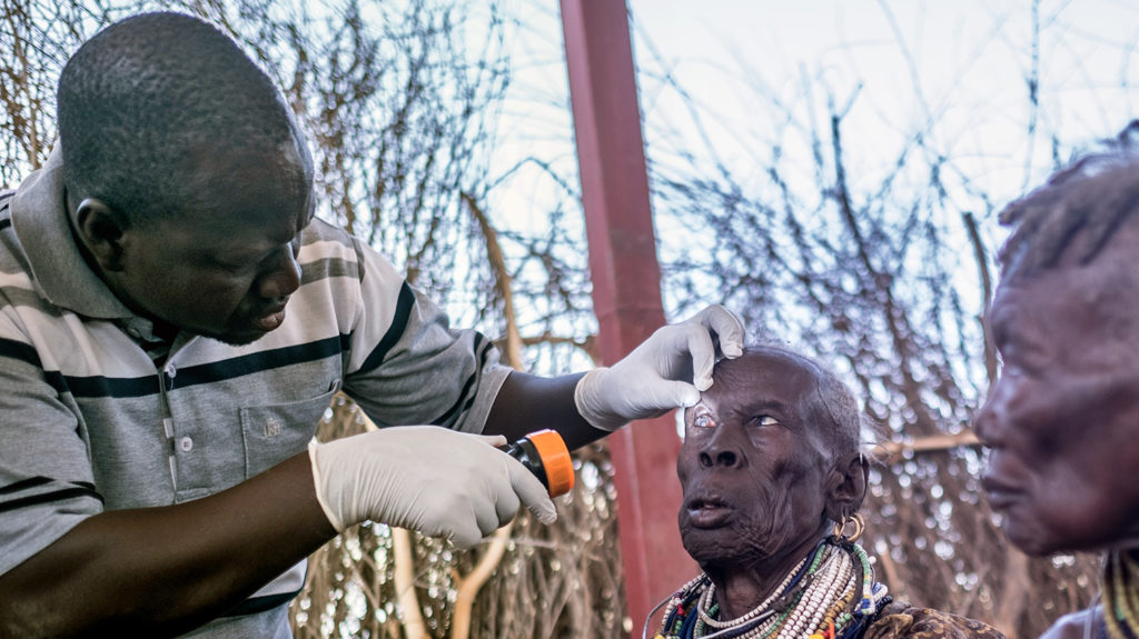 Eye surgeon Samson Lokele inspects a patient before her eye surgery.