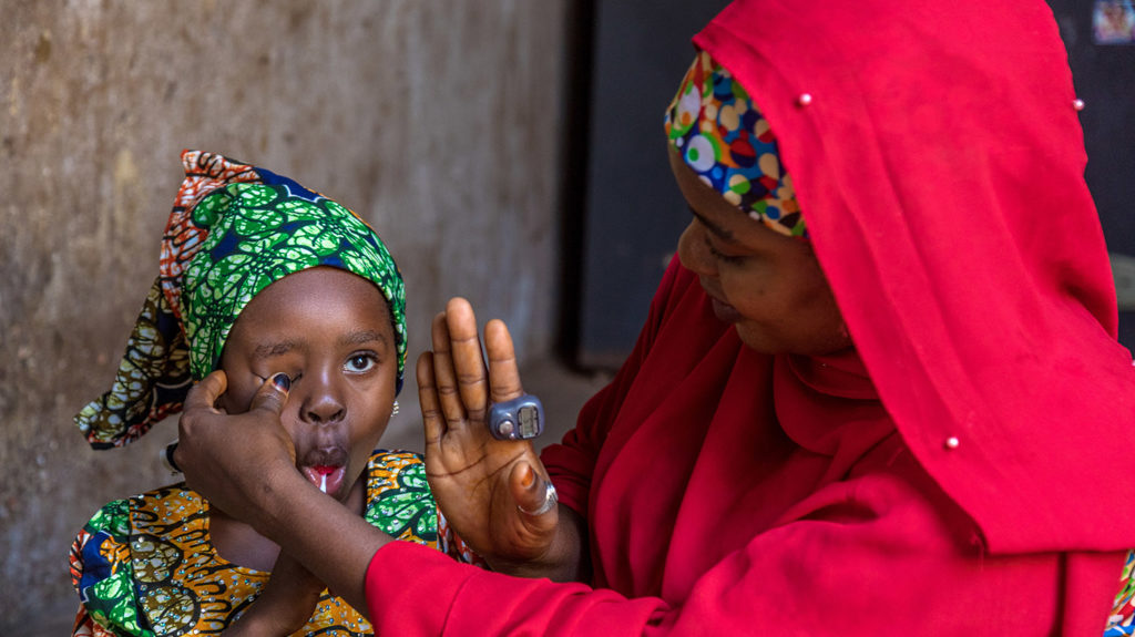 Shafa tests her daughter's eyes.