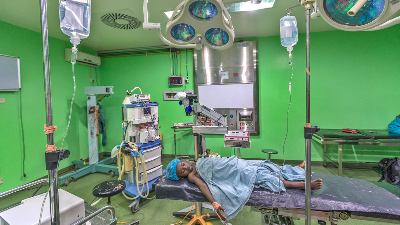 Khadijah lies in the operating theatre before her surgery.
