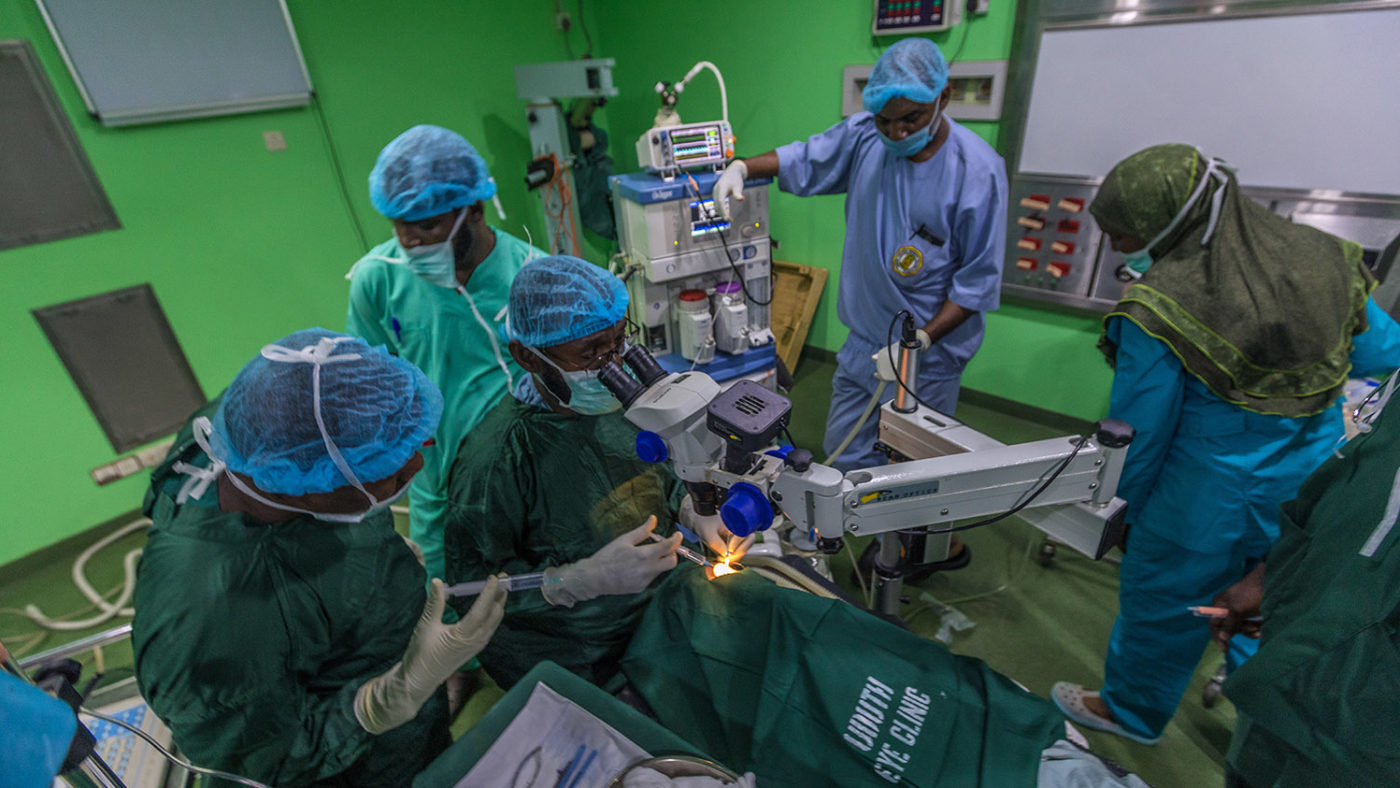 A group of medical staff surround Khadijah during her operation.