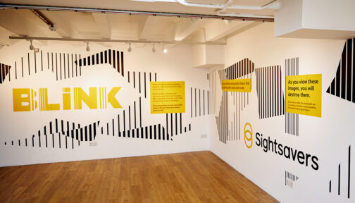 Sightsavers' BLINK exhibition in London, featuring the BLINK logo and the Sightsavers logo.