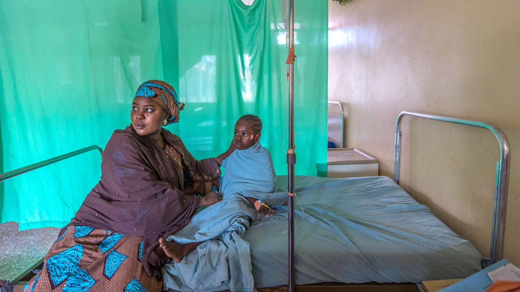 Shafa and Khadijah wait on a hospital bed before her operation.