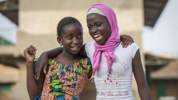Two girls smiling
