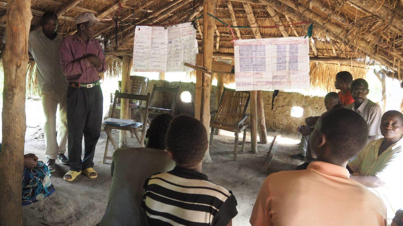 Community volunteers look at data in South Sudan.