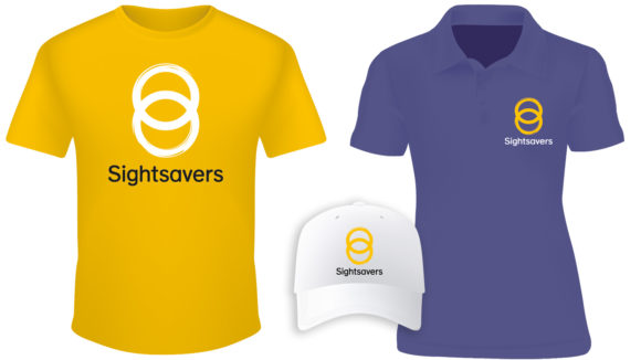 Examples of Sightsavers-branded clothing: a yellow t-shirt, a lilac polo shirt and a white baseball cap.
