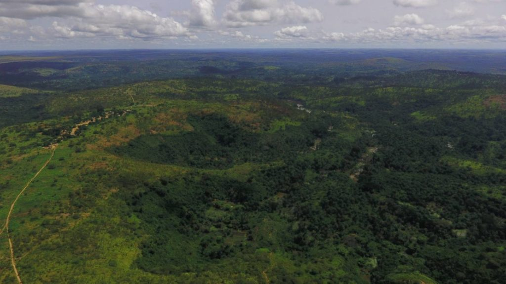 A drone image of the beautiful, lush, green landscape of the Democratic Republic of the Congo