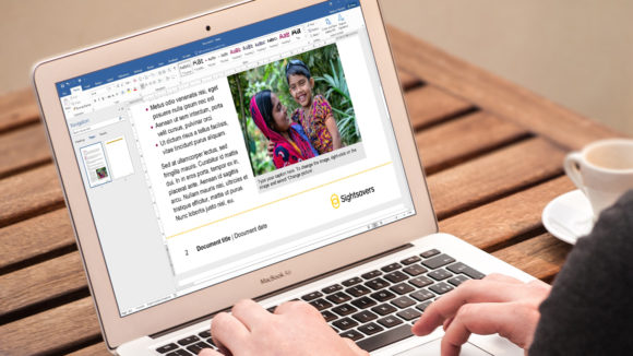 A close-up of a laptop screen showing a Sightsavers Word document.