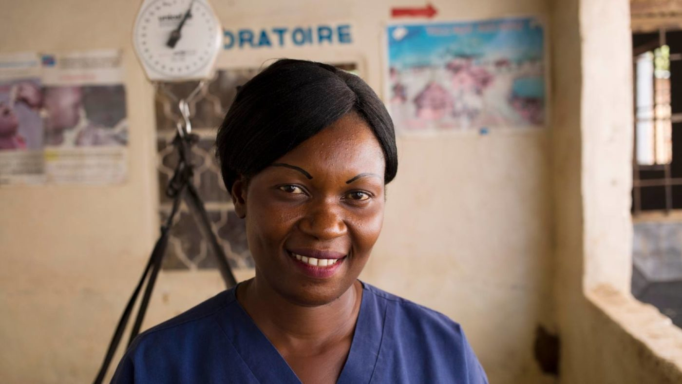 A female nurse stands for a portrait in a community health centre.