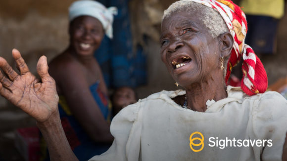 An example of a social media image in portrait orientation, showing a woman smiling and a Sightsavers logo.