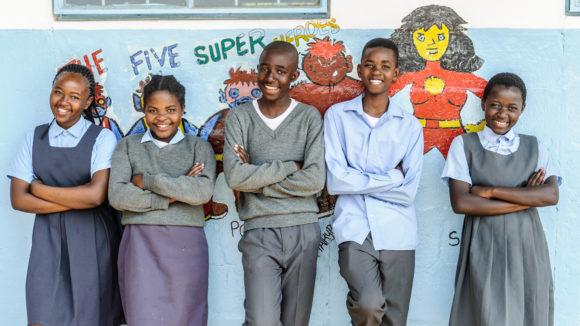 Five twelve-year-olds taking part in Super School of 5 at Chikonkomene Primary in Chikankata, Zambia.