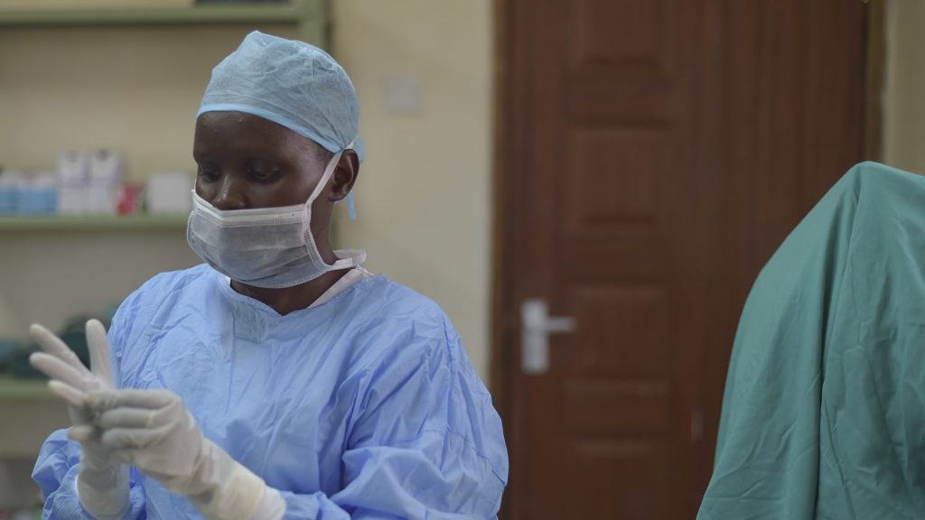 A surgeon dressed in scrubs prepares for theatre