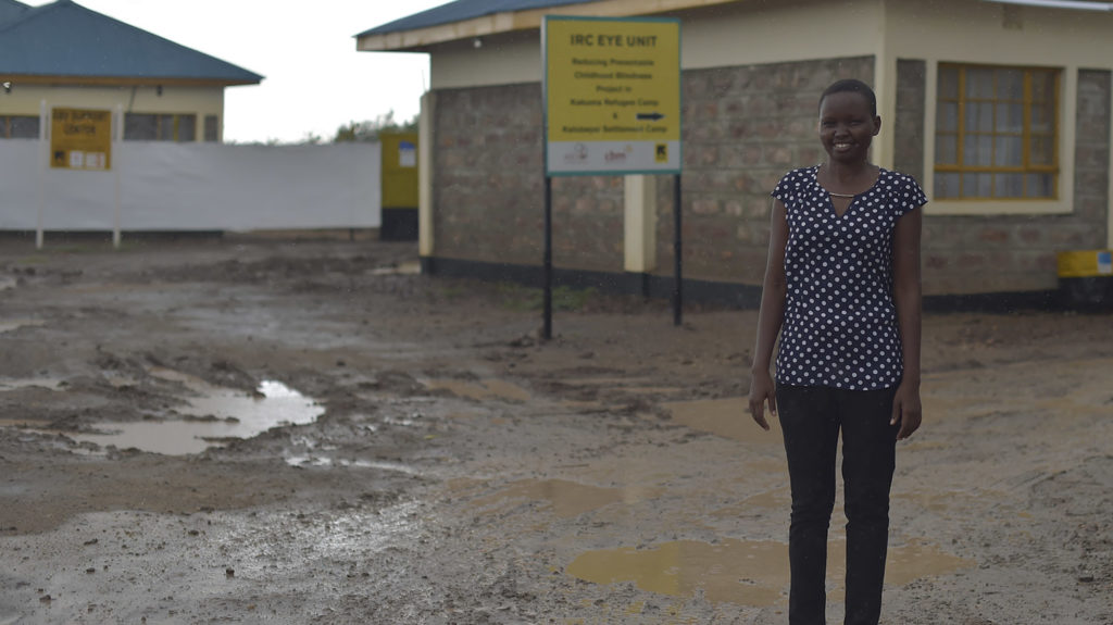 Elizabeth stands outside an eye clinic.