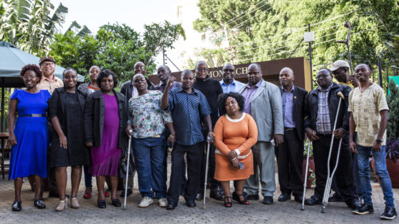 A group of Disabled Person Organisation (DPO) representatives meet in Nairobi, Kenya for advocacy training and planning as part of the Inclusive Futures initiative.
