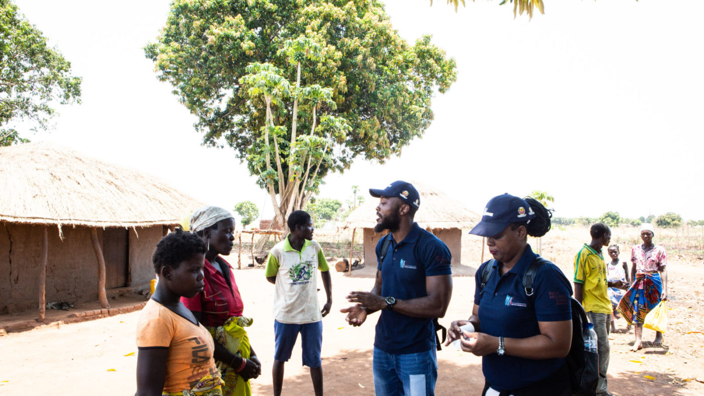 The survey team for the Onchocerciasis Elimination Mapping project explain to community members what is involved in the survey.