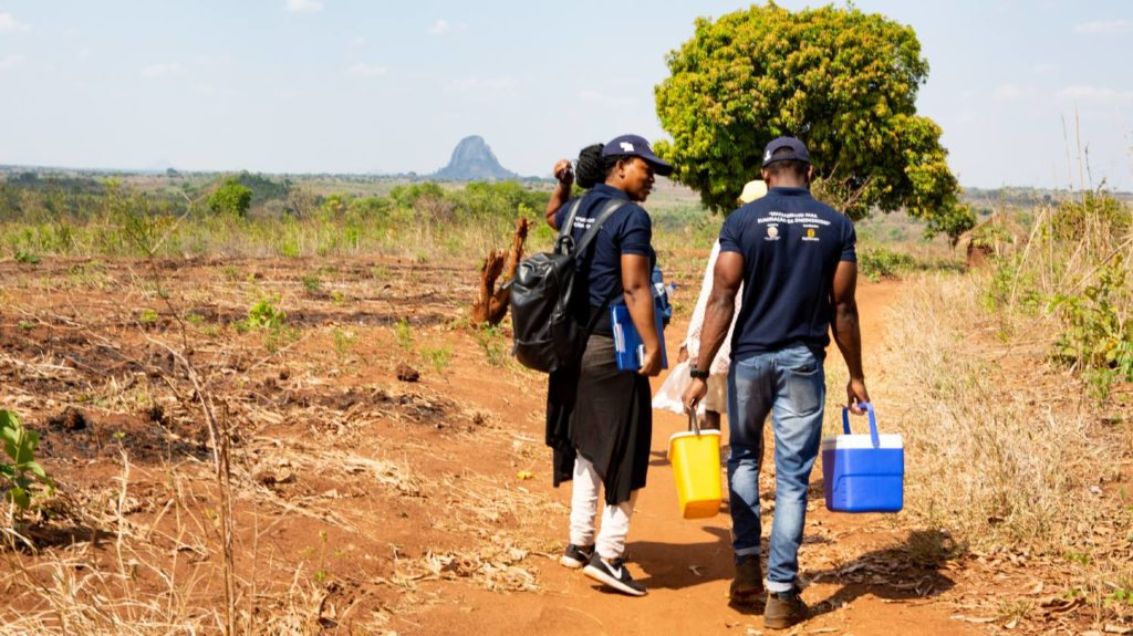 The survey team for the Onchocerciasis Elimination Mapping project in Mozambique walk through the community