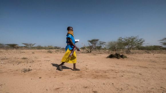 Community health volunteer Ngurotin Lung'Or walks through the bush in the Turkana region of Kenya to perform eye checkups.