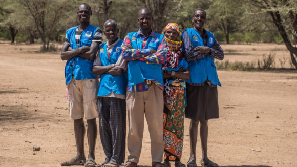 Community health volunteers stand outside in Nachuru, Turkana, Kenya.